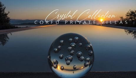 A crystal ball infront of a swimming pool during sunset in Corfu, symbolizing the Crystal Collection